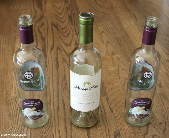 A St. Patrick's Day DIY project with old wine bottles. craft | diy | wine bottles | corks | buttons | green and gold | ribbon | what a cute idea!